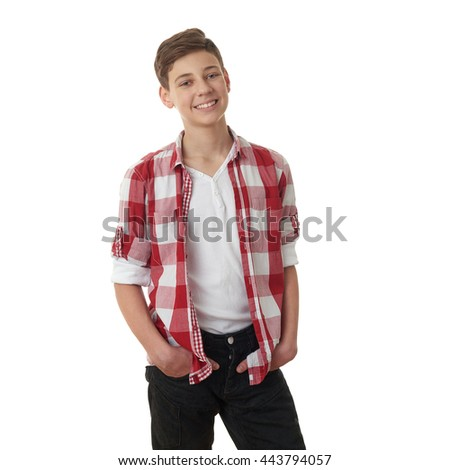 Cute teenager boy in red checkered shirt over white isolated background, half body - stock photo