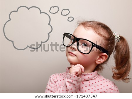 Cute thinking kid girl in glasses with empty bubble looking - stock photo