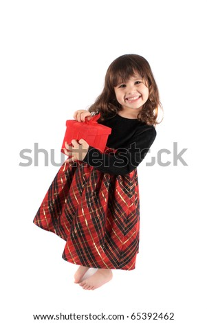 Cute three year old little girl dressed up in a fancy dress and holding a red giftbox smiling and standing barefoot on a white background - stock photo