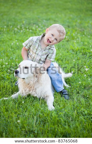 Cute toddler blonde boy with golden retriever hugging close up - stock photo