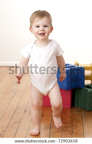 Cute toddler boy learning how to walk. - stock photo