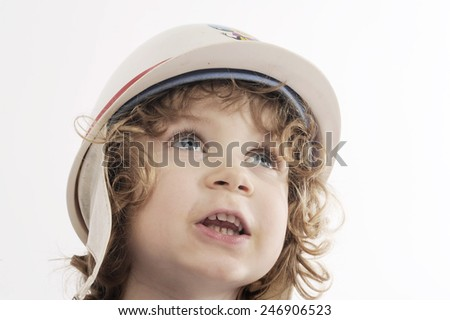 cute toddler boy with protect cap - stock photo