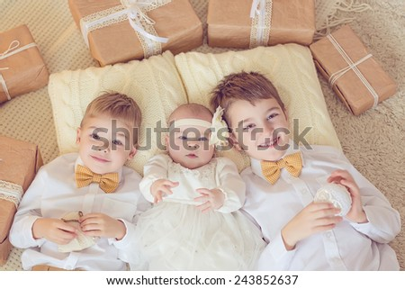 Cute toddler boys and little girl with gift boxes  - stock photo
