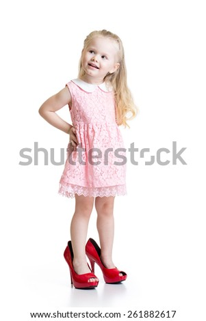 Cute toddler girl wearing big shoes isolated - stock photo