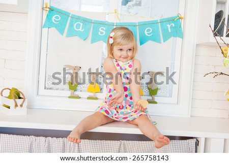 Cute toddler girl with easter decoration - stock photo