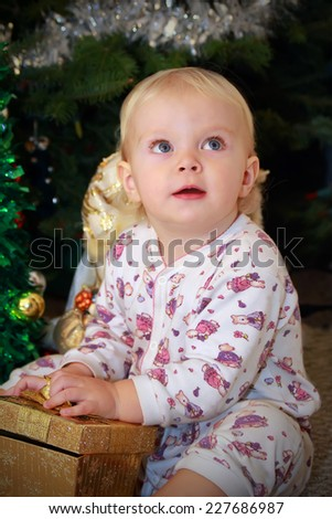 Cute toddler girl with the Christmas gift box  - stock photo