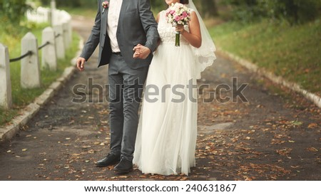 cute wedding couple. young caucasian bride and groom - stock photo