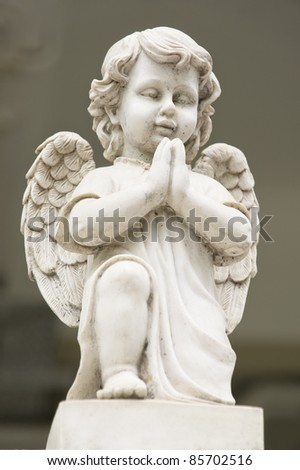 Cute winged Angel statue in praying pose - stock photo