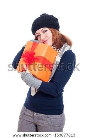 Cute winter woman holding present, isolated on white background. - stock photo