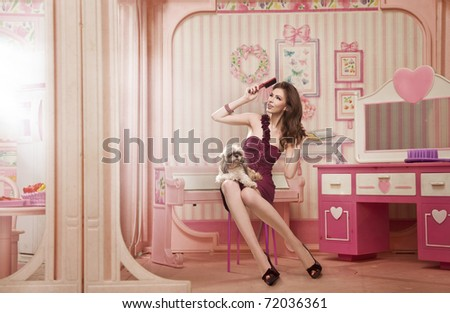Cute woman as a doll in her living room - stock photo