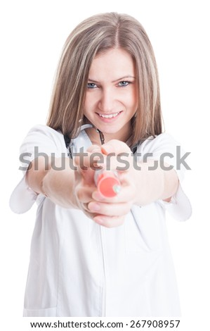 Cute woman doctor ponting a syringe to the camera isolated on white background - stock photo