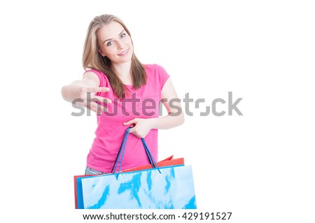 Cute woman holding shopping bags and showing number four and smiling isolated on white with copyspace - stock photo