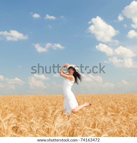 Cute woman in golden wheat - stock photo