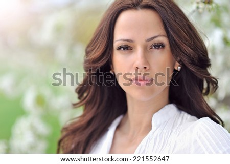 Cute woman in the park in summer  - stock photo