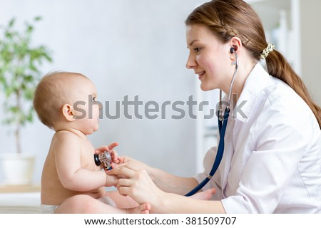 Cute woman pediatrician examining of baby kid with stethoscope - stock photo