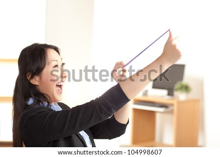 Cute woman playing with rubberbands - stock photo