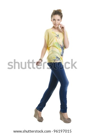 Cute woman posing in jeans and bright top over white - stock photo
