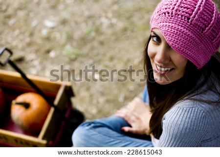 cute woman pumpkin picking - stock photo