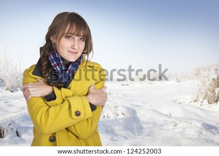 Cute Woman Shivering on a cold winter day - stock photo