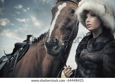 Cute woman with horse - stock photo