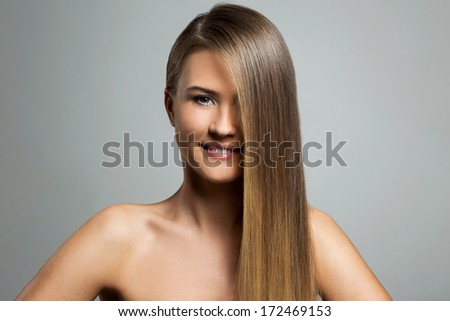 Cute woman with long hair - stock photo