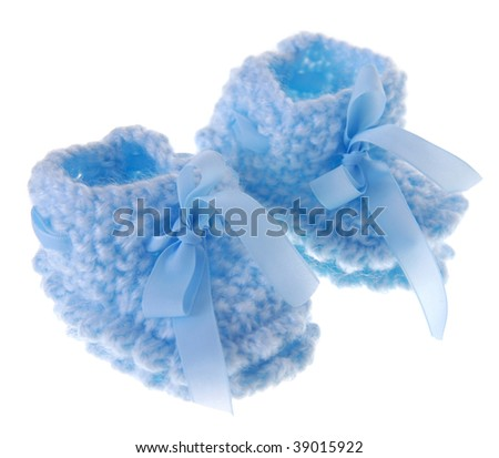 Cute woolen baby shoes on white background - stock photo