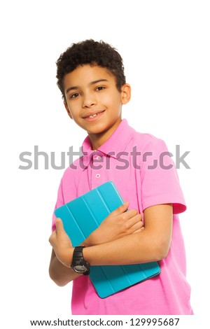 Cute 10 years old black boy standing with tablet computer, full height, close-up portrait - stock photo