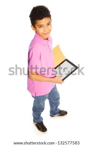Cute 10 years old black boy standing with tablet computer, full height, isolated on whtie, top view - stock photo