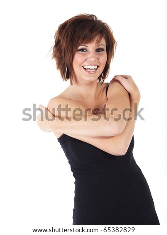 Cute young adult caucasian woman wearing a black top and with short brunette hair on a white background. Not Isolated - stock photo