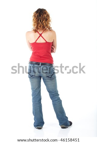 Cute young adult caucasian woman wearing a red top and jeans and with curly red hair on a white background. Not Isolated - stock photo