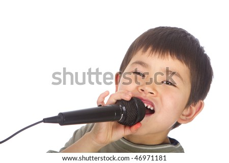 Cute young asian boy singing into a microphone isolated on a white background - stock photo