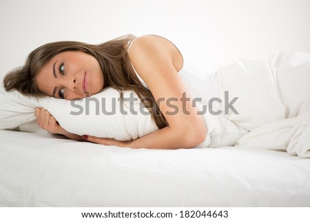 Cute young beautiful girl thinking and resting in the bed at morning. - stock photo