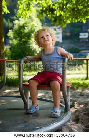 cute young boy at the playground - stock photo