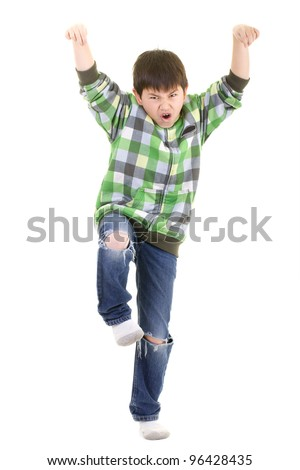 Cute young boy doing the karate kid pose isolated on white background - stock photo