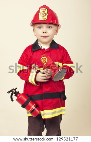Cute Young Boy in a Fireman's Costume - stock photo