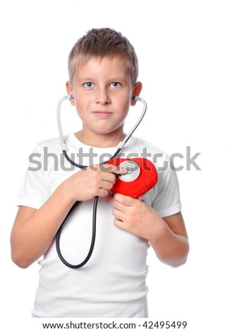 cute young boy playing doctor with stethoscope - stock photo