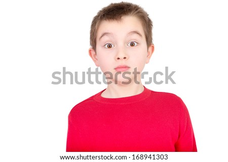 Cute young boy staring in amazement with a startled wide-eyed expression as he reacts in shock to something, isolated on white - stock photo