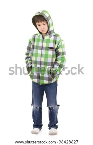 Cute young boy with bored or sad look in colorful hoodie isolated on white background - stock photo