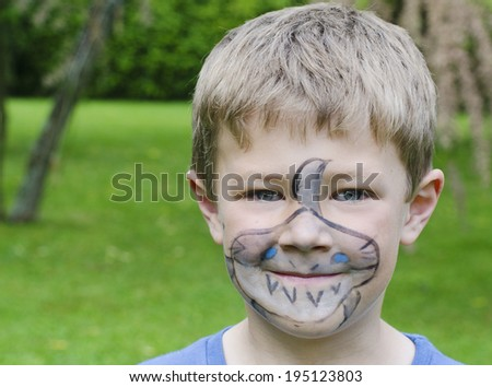 Cute young boy with with shark face painting - stock photo