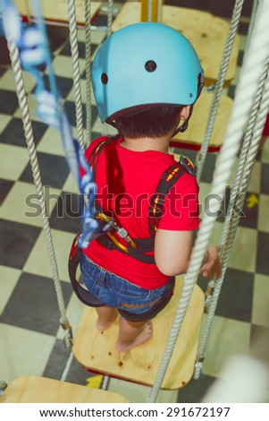 Cute young child boy or kid playing in kid playground. Cheerful asian boy - stock photo