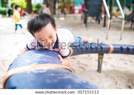 Cute young child boy or kid playing on school playground - stock photo