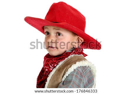 Cute young cowboy wearing red had and bandanna - stock photo