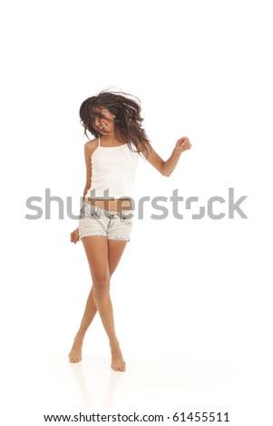 Cute young energetic girl dancing - stock photo