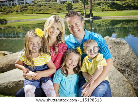 Cute Young Family Portrait - stock photo