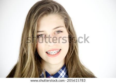 Cute young female teenager smiling closeup - stock photo