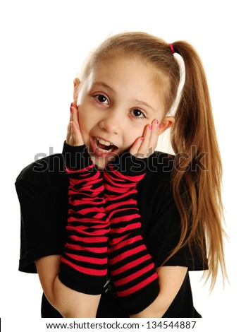 Cute young girl isolated on a white background, wearing pirate punk gloves with surprised face expression - stock photo