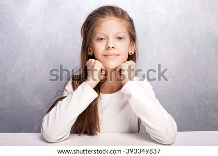 Cute young girl looking at camera. Beauty portrait. Studio shot. - stock photo