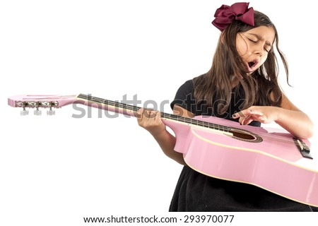 Cute young girl playing guitar and sing . - stock photo