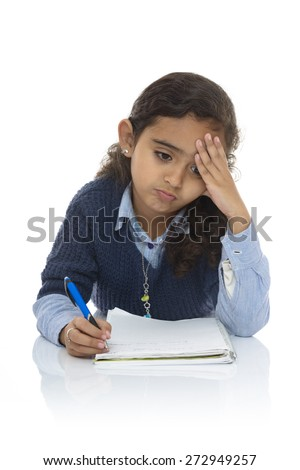 Cute Young Girl Studying Hard Isolated on White Background - stock photo