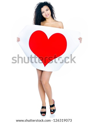 Cute young girl with a Valentine's card over white - stock photo